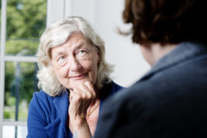 Mature caucasian woman taking part in a counseling session.