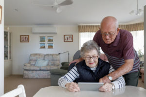 Senior Australian Couple Learning To Use Digital Tablet While Living Independently In Their Own Home